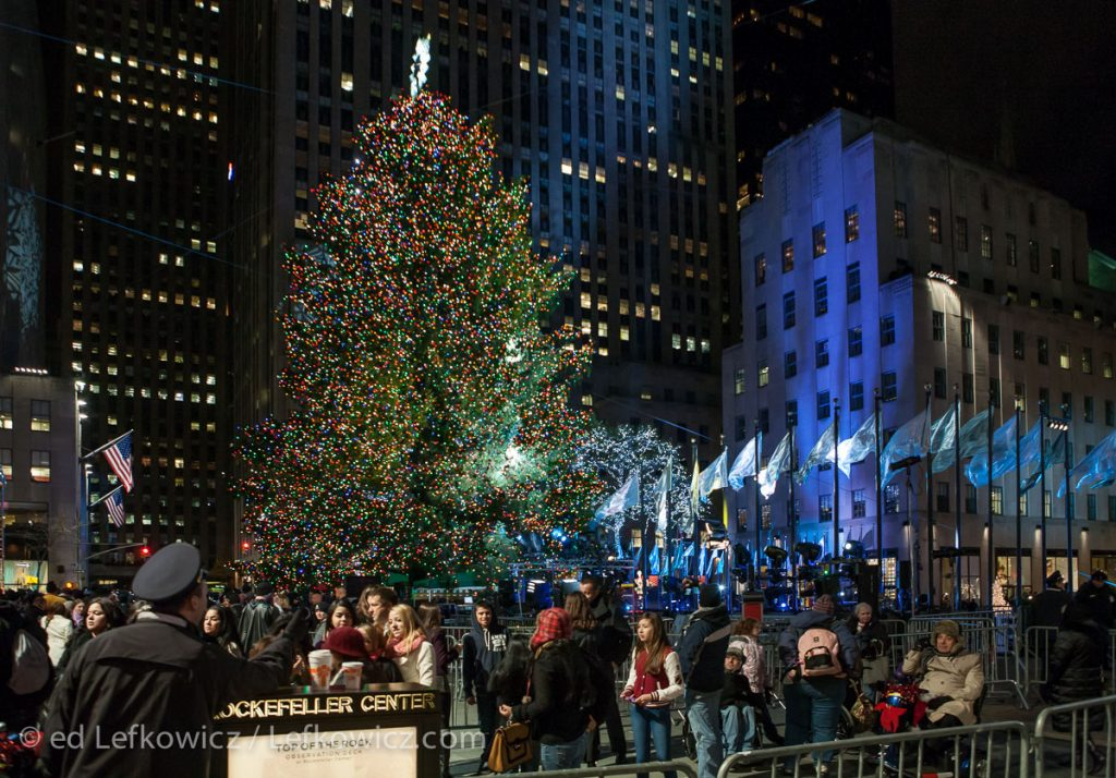 Tourists gather around the Christmas tree at Roickefeller Center.